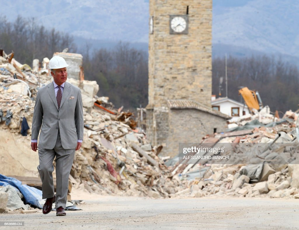 TOPSHOT - Britain's Prince Charles, Prince of Wales, visits the Italian quake-hit town of Amatrice on April 2, 2017 as part of his European tour aimed at strengthening relations with EU allies post Brexit. /