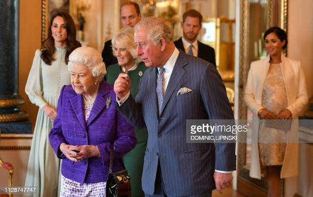 TOPSHOT Britain's Prince Charles Prince of Wales walks with his mother Britain's Queen Elizabeth II and his wife Britain's Camilla Duchess of...