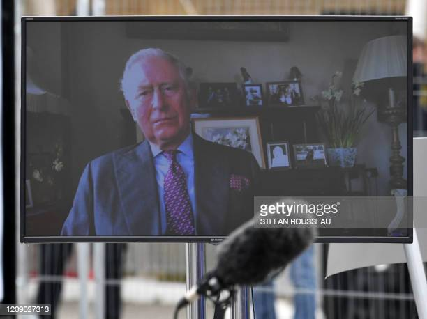 Britain's Prince Charles Prince of Walesa is seen on a monitor as he speaks during the opening of the NHS Nightingale field hospital created at the...