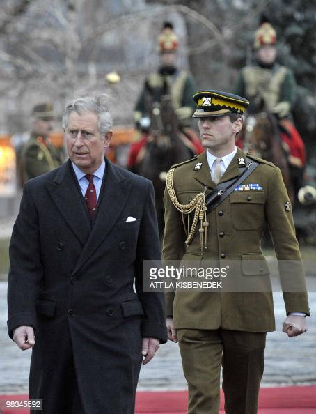 Britain's Prince Charles reviews an honor guard in front ...
