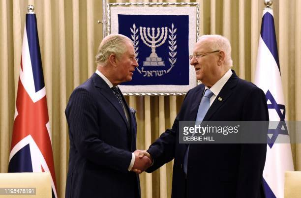 Britain's Prince Charles shakes hands with Israeli President Reuven Rivlin at the presidential residence in Jerusalem ahead of a meeting on the...
