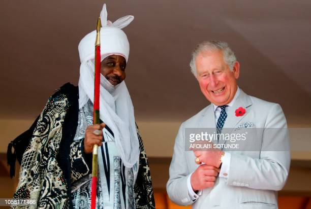 Britain's Prince Charles shares a light moment with the Emir of Kano Lamido Sanusi as they look at a book during his meeting with traditional leaders...