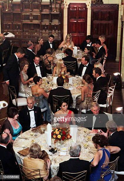 Britain's Prince Charles , sits at a table with and America Ryder Cup Team Captain, Corey Pavin , and Europe Ryder Cup Team Captain, Colin...