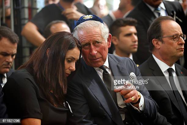 Britain's Prince Charles speaks to Israeli Minister of Sport and Culture Miri Regev as French President Francois Hollande sits nearby during the...