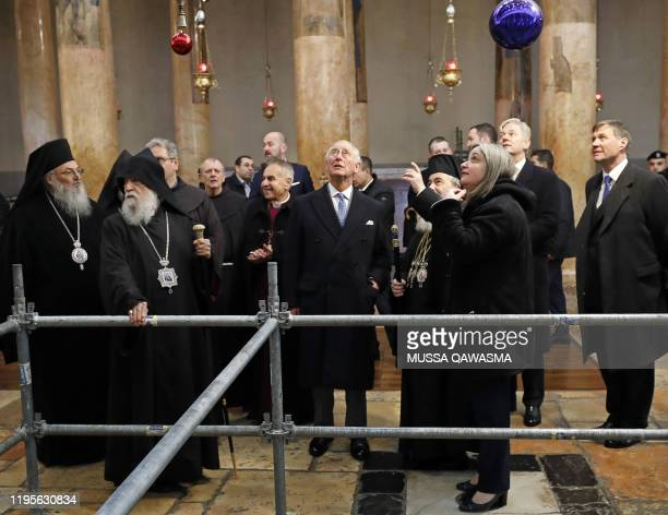 Britain's Prince Charles stands next to Theophilos III , the Greek Orthodox Patriarch of Jerusalem, during a visit to the Church of the Nativity in...