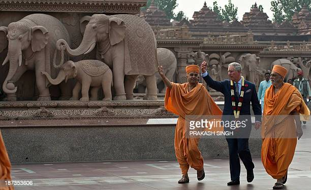 Britain's Prince Charles talks with Hindu priests during a visit to the Akshardham temple in New Delhi on November 8 2013 Britain's Prince Charles is...