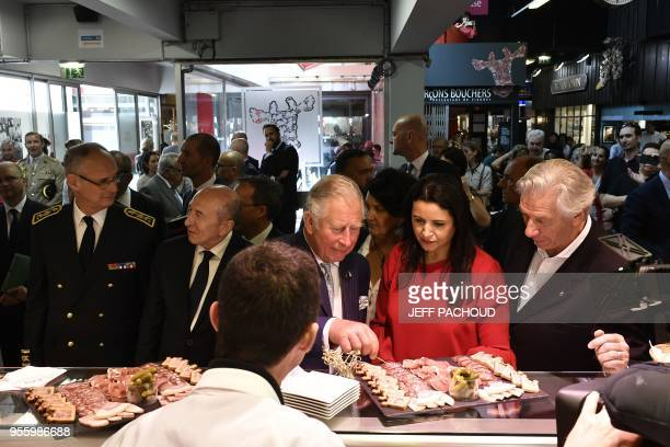 Britain's Prince Charles the Prince of Wales and French Interior Minister Gerard Collomb visit the Halles de Lyon in Lyon central eastern France on...