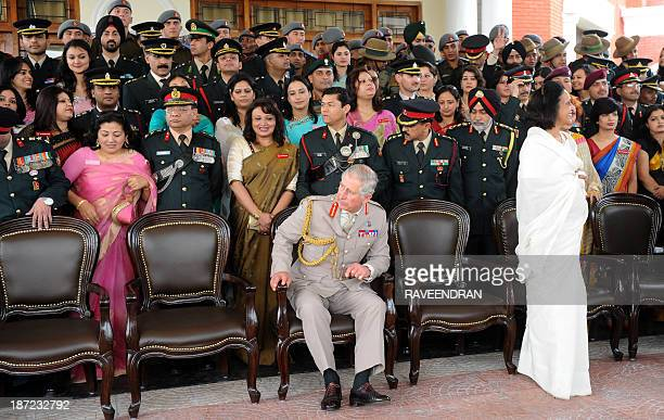 Britain's Prince Charles waits for others to arrive for a group photo shoot with Indian Army officers and their families during a visit to The Indian...
