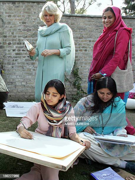 Britain's Prince Charles wife Camilla Duchess of Cornwall watches as students draw during a class at Fatima Jinnah University in Rawalpindi 31...