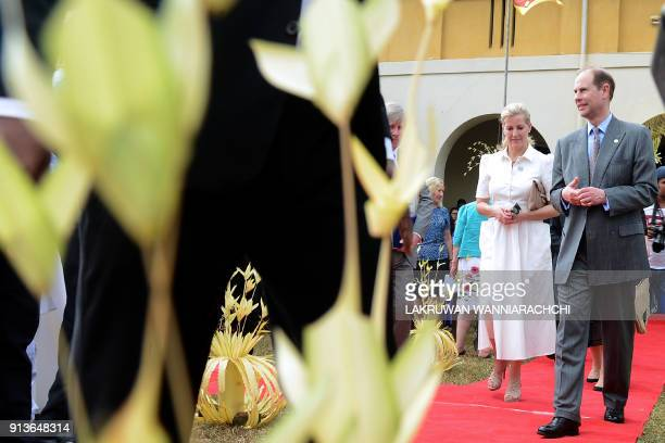 Britain's Prince Edward and his wife Sophie walk during a meeting with students of Sri Lanka's schools for the deaf and blind near the capital...