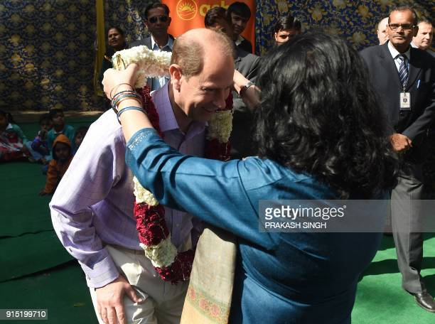 Britain's Prince Edward Earl of Wessex is welcomed during a visit to a community centre run by the NGO Asha in New Delhi on February 7 2018 Edward...