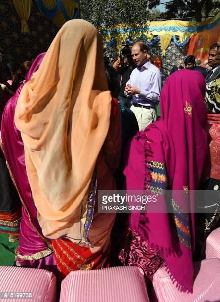 Britain's Prince Edward Earl of Wessex visits a community centre run by the NGO Asha in New Delhi on February 7 2018 Edward the third son of...