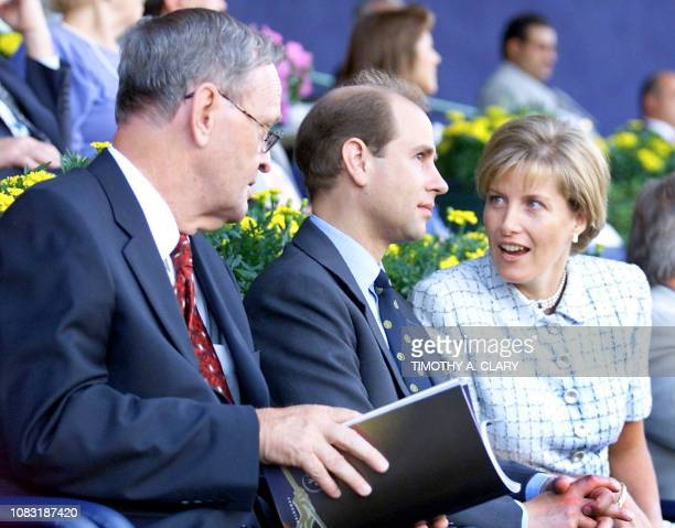 Britain's Prince Edward listens to his wife Sophie the Countess of Wessex flankedd by Canadian Prime Minister Jean Chretien at the Commonwealth...