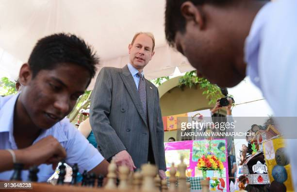 Britain's Prince Edward looks on as two students play chess during a meeting with students of Sri Lanka's schools for the deaf and blind near the...