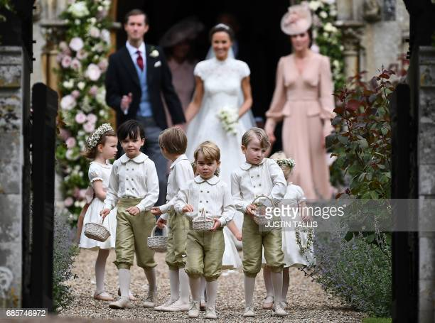 Britain's prince George , a pageboy, reacts following the wedding of his aunt Pippa Middleton to her new husband James Matthews , at St Mark's Church...