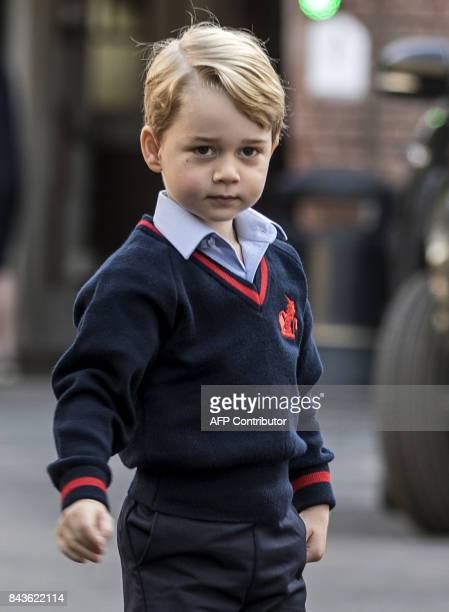 Britain's Prince George arrives for his first day of school at Thomas's school in Battersea, southwest London on September 7, 2017. / AFP PHOTO /...