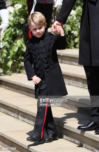 Britain's Prince George walks down the west steps after attending the wedding ceremony of Britain's Prince Harry Duke of Sussex and US actress Meghan...