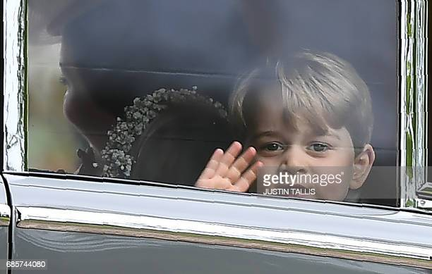 Britain's Prince George waves as he leaves in a car after attending the wedding of his aunt, Pippa Middleton, to James Matthews at St Mark's Church...