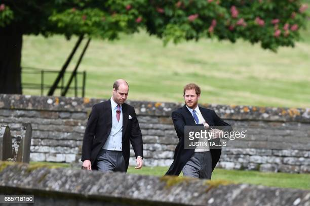 Britain's Prince Harry and Britain's Prince William, Duke of Cambridge arrive at the church for the wedding of Pippa Middleton and James Matthews at...