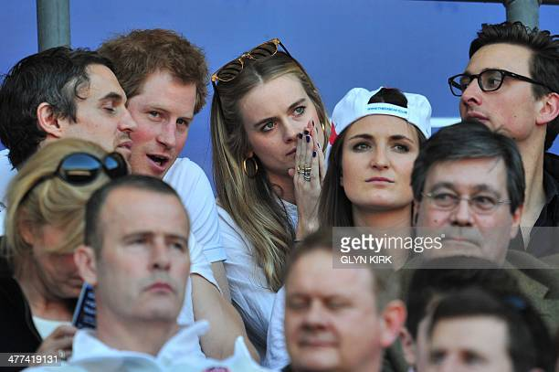 Britain's Prince Harry and British socialite Cressida Bonas watch the match during the Six Nations International rugby Union match between England...