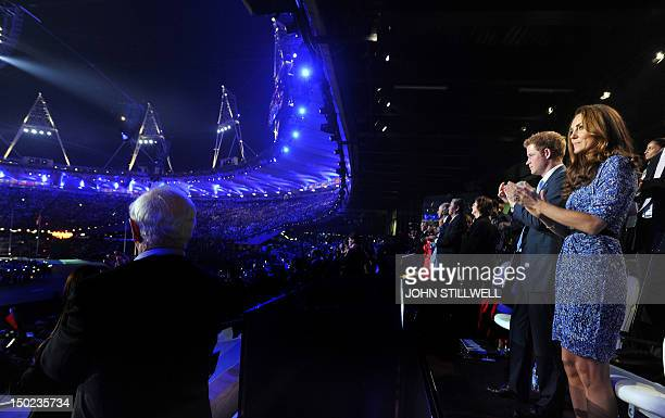 Britain's Prince Harry and Catherine Duchess of Cambridge attend the closing ceremony of the 2012 London Olympic Games in east London on August 12...
