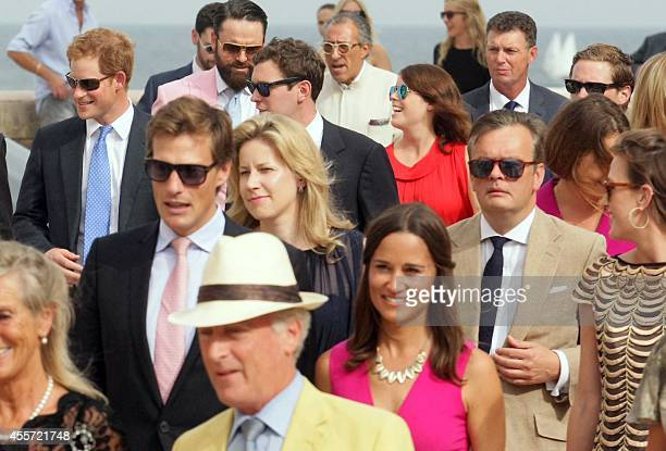 Britain's Prince Harry and Duchess of Cambridge Kate Middleton's sister Pippa arrive to attend the wedding ceremony of Charlie Gilkes and Anneke von...
