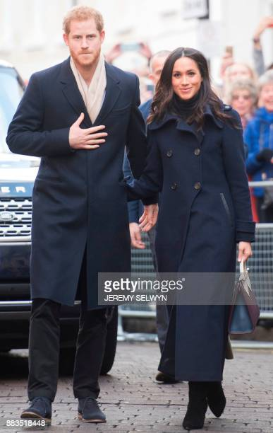 Britain's Prince Harry and fiancee US actress Meghan Markle greets wellwishers on a walkabout as they arrive for an engagement at Nottingham...