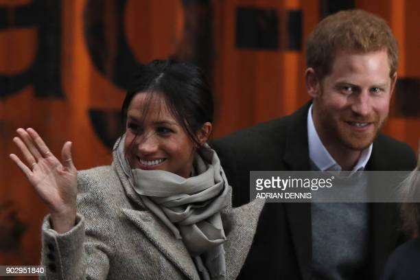 Britain's Prince Harry and his fiancée US actress Meghan Markle arrive for their visit to Reprezent 1073FM community radio station in Brixton south...