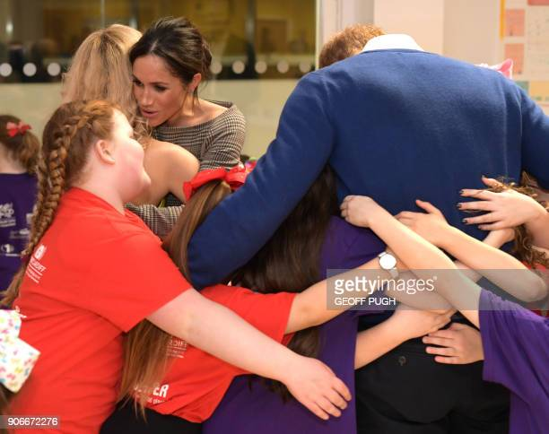 Britain's Prince Harry and his fiancée US actress Meghan Markle attend a street dance class during their visit to Star Hub community and leisure...