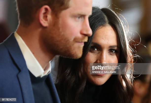 Britain's Prince Harry and his fiancée US actress Meghan Markle attend a reception for young people at the Palace of Holyroodhouse in Edinburgh...