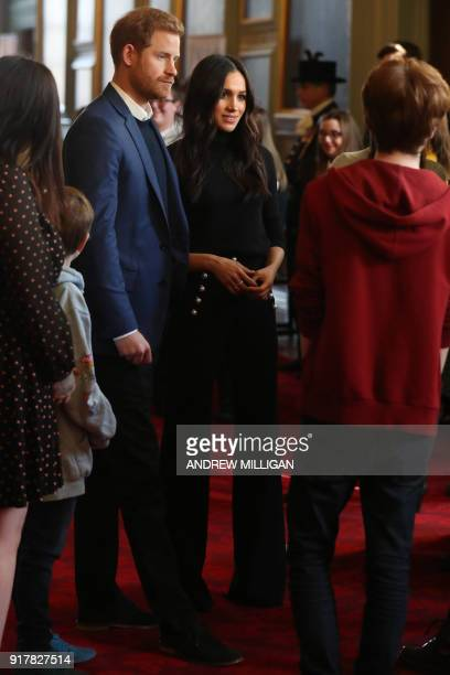 Britain's Prince Harry and his fiancée US actress Meghan Markle attend a reception for young people in the Palace of Holyroodhouse in Edinburgh...