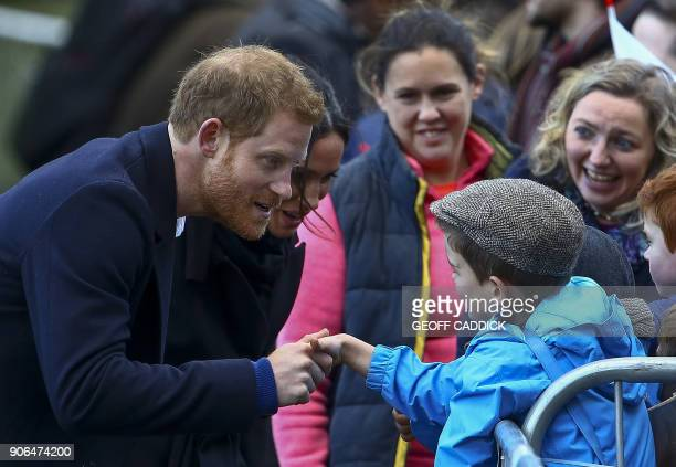 Britain's Prince Harry and his fiancée US actress Meghan Markle greet wellwishers on their arrival to Cardiff Castle in Cardiff south Wales on...