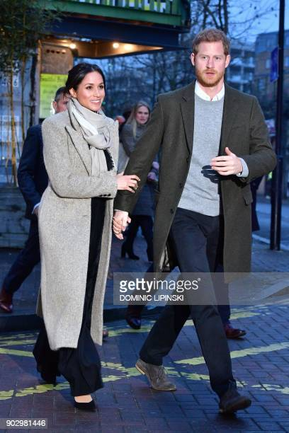 Britain's Prince Harry and his fiancée US actress Meghan Markle leave after their visit to Reprezent 1073FM community radio station in Brixton south...