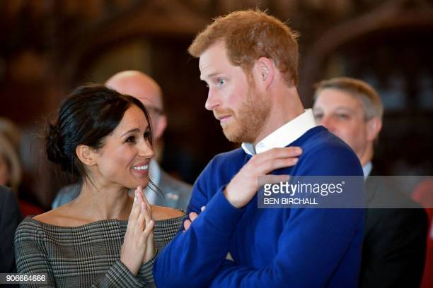 Britain's Prince Harry and his fiancée US actress Meghan Markle watch a dance performance by Jukebox Collective in the banqueting hall during a visit...