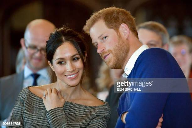 TOPSHOT Britain's Prince Harry and his fiancée US actress Meghan Markle watch a dance performance by Jukebox Collective during a visit at Cardiff...