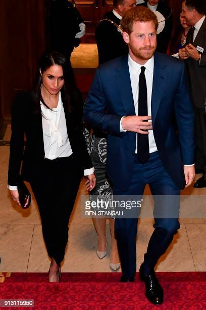 Britain's Prince Harry and his fiancee US actress Meghan Markle arrive to attend the annual Endeavour Fund Awards at Goldsmiths' Hall in London on...