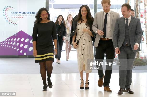 Britain's Prince Harry and his fiancee US actress Meghan Markle arrive to attend a reception with delegates from the Commonwealth Youth Forum in...