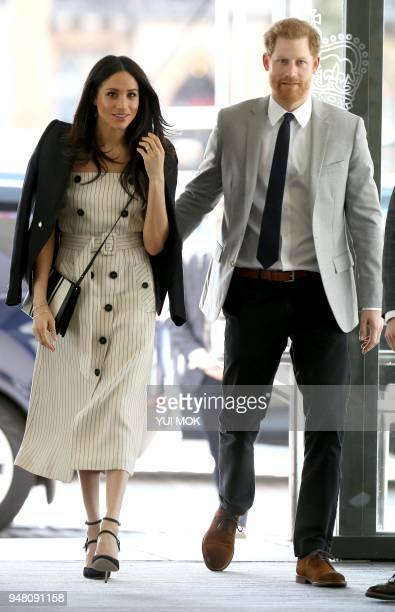 TOPSHOT Britain's Prince Harry and his fiancee US actress Meghan Markle arrive to attend a reception with delegates from the Commonwealth Youth Forum...
