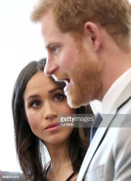 Britain's Prince Harry and his fiancee, US actress Meghan Markle, attend a reception with delegates from the Commonwealth Youth Forum in central...