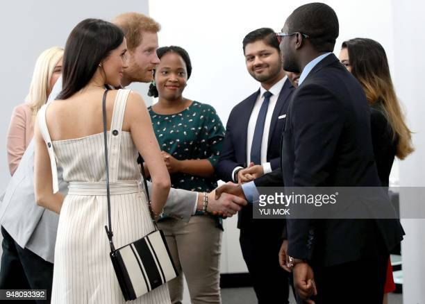 Britain's Prince Harry and his fiancee US actress Meghan Markle attend a reception with delegates from the Commonwealth Youth Forum in central London...