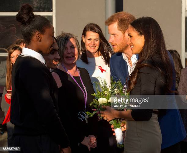 Britain's Prince Harry and his fiancee US actress Meghan Markle meet head teachers and pupils during their visit to Nottingham Academy in Nottingham...