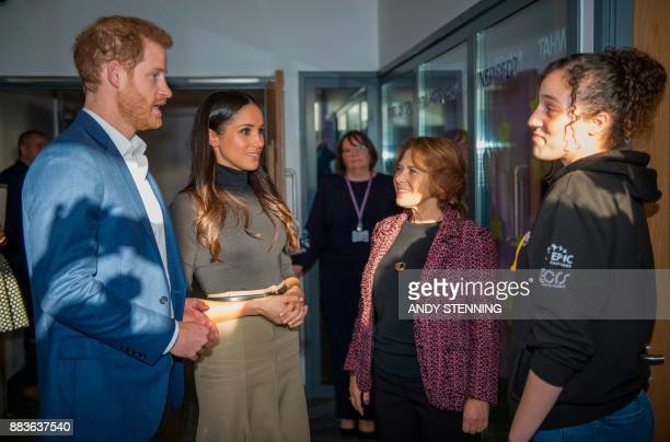 Britain's Prince Harry and his fiancee US actress Meghan Markle meet Chantelle Stefanovic a project coordinator at the Full Effect programme which...