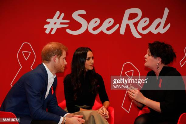 Britain's Prince Harry and his fiancee US actress Meghan Markle take part in a discussion with HIV consultant doctor Laura Waters during their visit...
