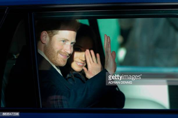 Britain's Prince Harry and his fiancee US actress Meghan Markle wave on their departure from the Terrence Higgins Trust World AIDS Day charity fair...