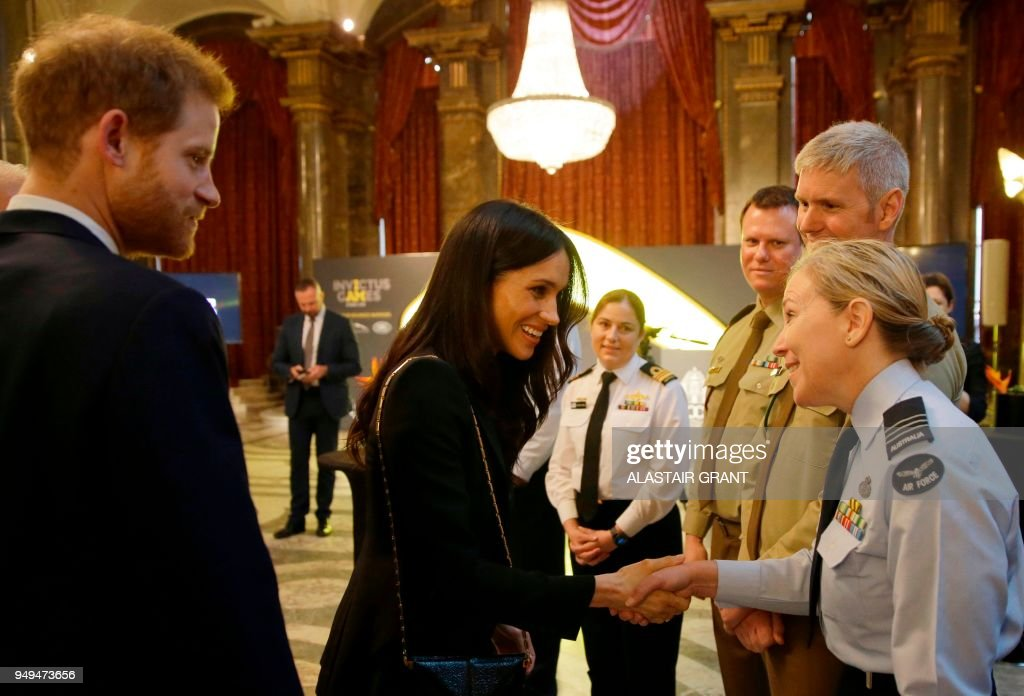 Britains prince harry l and his financee us actress meghan markle britains prince harry l and his financee us actress meghan markle r greet members of the australian defence force at a reception for invictus games at m4hsunfo