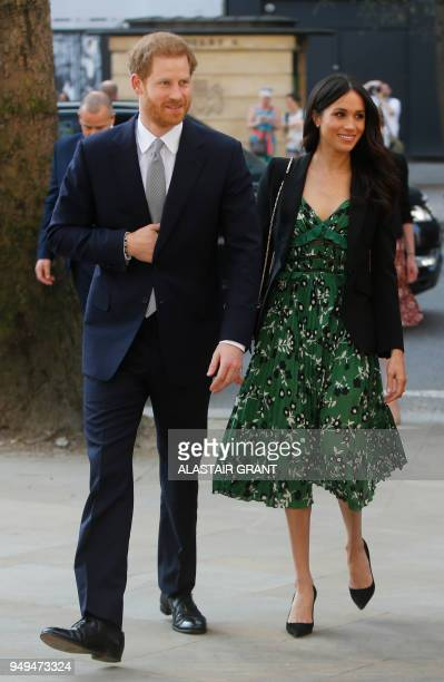 Britain's Prince Harry and his financee US actress Meghan Markle arrive to attend a reception for Invictus Games at Australia House in London on...