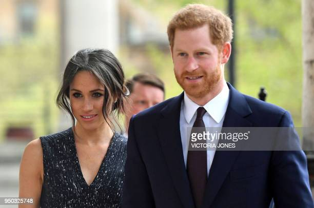 Britain's Prince Harry and his US fiancee Meghan Markle arrive to attend a memorial service at St MartinintheFields in Trafalgar Square in London on...