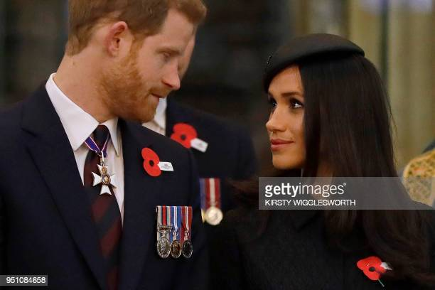 TOPSHOT Britain's Prince Harry and his US fiancee Meghan Markle attend a service of commemoration and thanksgiving to mark Anzac Day in Westminster...