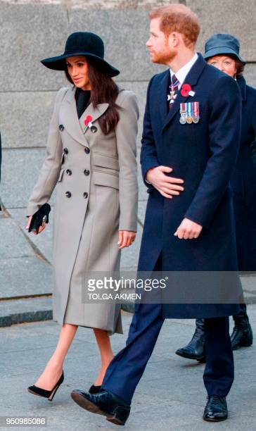 Britain's Prince Harry and his US fiancee Meghan Markle attend an Anzac Day dawn service at Hyde Park Corner in London on April 25 2018 Anzac Day...