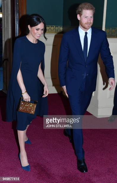 Britain's Prince Harry and his US fiancee Meghan Markle attend The Queen's Birthday Party concert on the occassion of Her Majesty's 92nd birthday at...